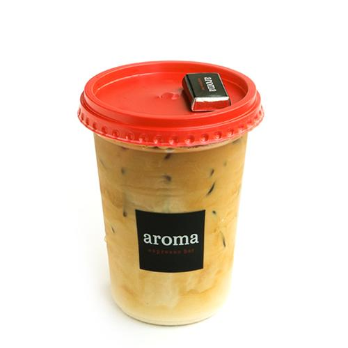 Iced Latte - Shots of Aroma's espresso blend over ice topped with milk.