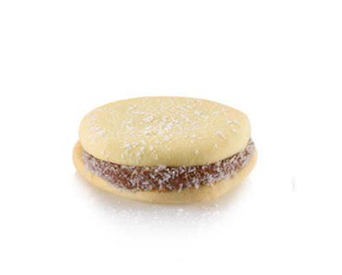 Alfajor - Our irresistible South American treat. Velvety dulce de leche caramel between two delicate and buttery shortbread cookies sprinkled with powdered sugar.